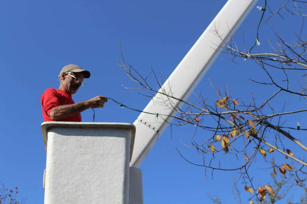 Hector Diaz of Hutchinson Tree Care decorates downtown New Canaan for the holidays on a previous fall day. Here is a list of local fundraisers that New Canaan residents can donate to for helping to service programs, and organizations in the town through sales, donations and yearly efforts of contributions for good causes.