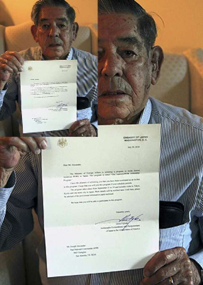 Ex-POW Joe Alexander holds a letter from the Japanese Embassy inviting him to visit Tokyo and Kyoto.