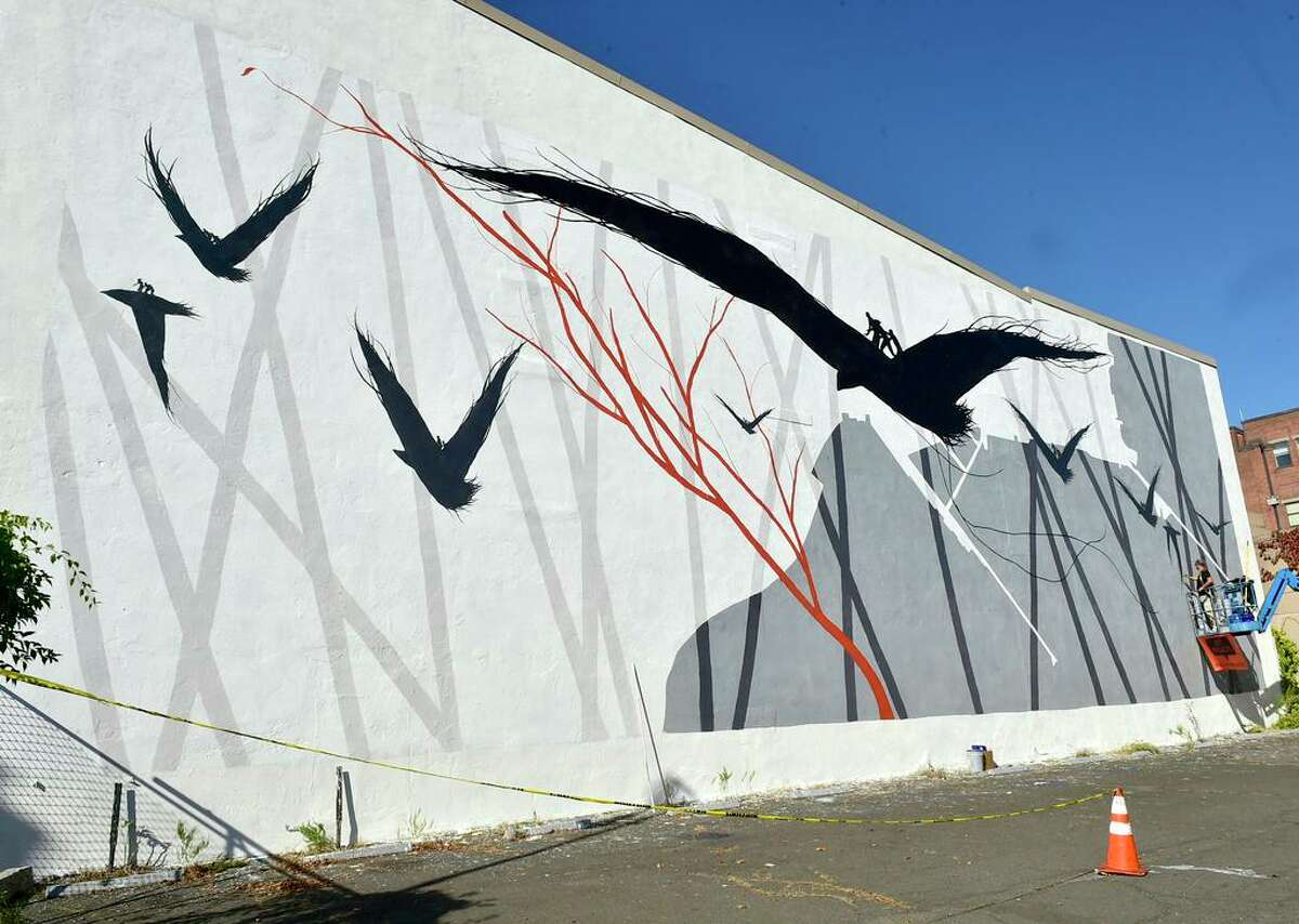 Nov. 7, 2020: Spanish artist David de la Mano of Uruguay paints a wall mural for Site Projects New Haven in the Ninth Square at 33 Crown Street as a tribute to William Lanson, the once enslaved man who expanded Long Wharf and helped build the Farmington Canal.