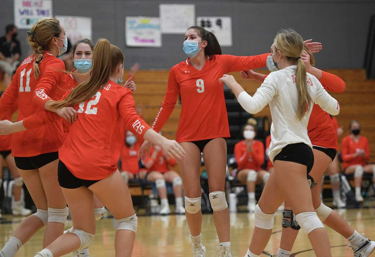 Isabel Voellmicke (#9) and her Ridgefield teammates celebrate a winning point during their 3-0 loss to Staples in the FCIAC Central volleyball championship match at Staples High School in Westport, Conn. on Tuesday, November 10, 2020.