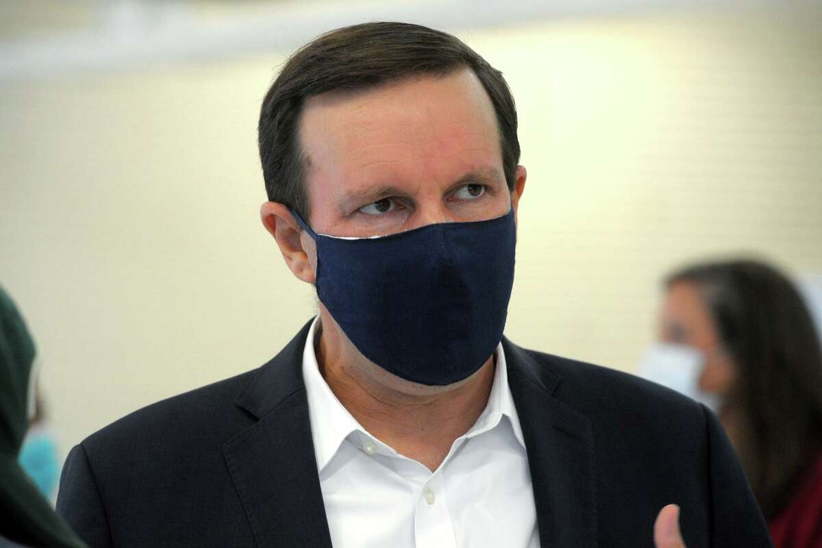 U.S. Sen. Chris Murphy speaks during an interview following a meeting at a Southwest Community Health Center facility in Bridgeport, Conn. Oct. 13, 2020.