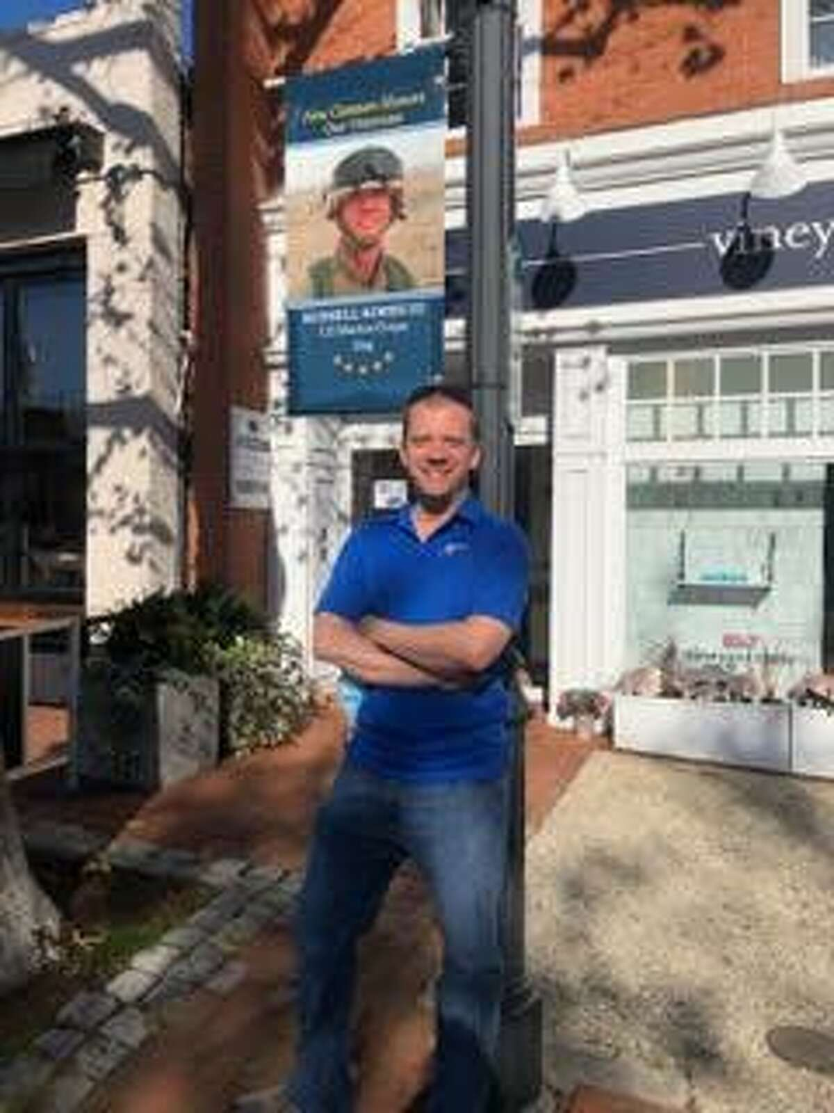 The New Canaan and Darien Moms of Military group had the honor of assisting in the hanging of the Veterans Banners, such as this one, in downtown New Canaan this past week. Veterans of Foreign Wars Post 653 in New Canaan Commander Russell A. Kimes III (pictured) was also in the downtown part of town when the banners were being put up.