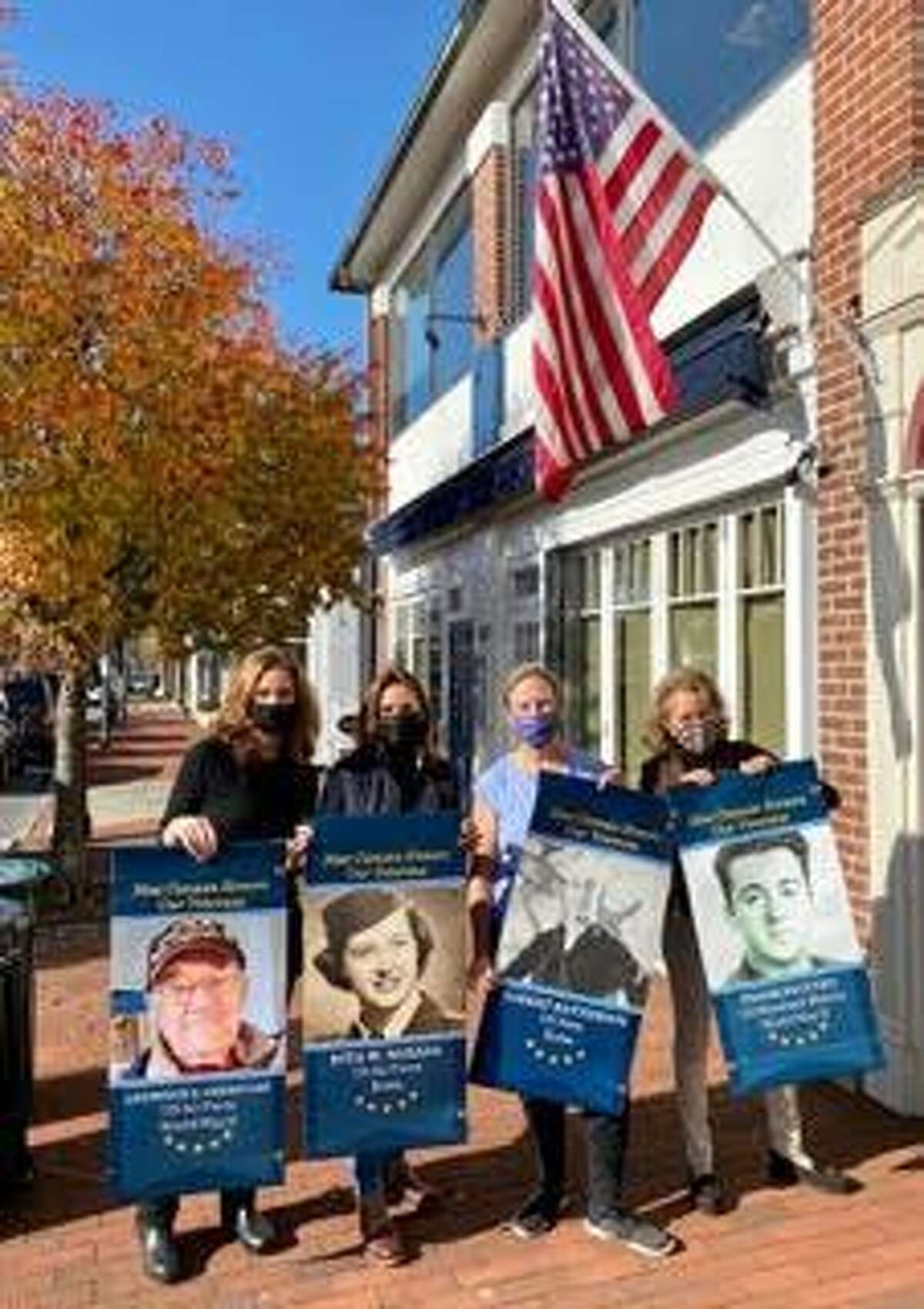 The New Canaan and Darien Moms of Military group had the honor of assisting in the hanging of the Veterans Banners in downtown New Canaan this past week, four members and banners of which are pictured.