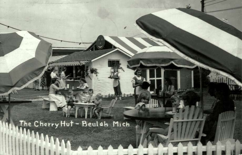 Outdoor diners and waitresses in the classic uniforms at the Cherry Hut during 1950's. (Courtesy Photo)