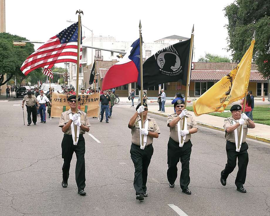 Vietnam Veterans Association honor guard members lead Association members as they participate in last year's Veterans Day Parade on Nov. 11, 2019. Photo: Cuate Santos / Laredo Morning Times / Laredo Morning Times
