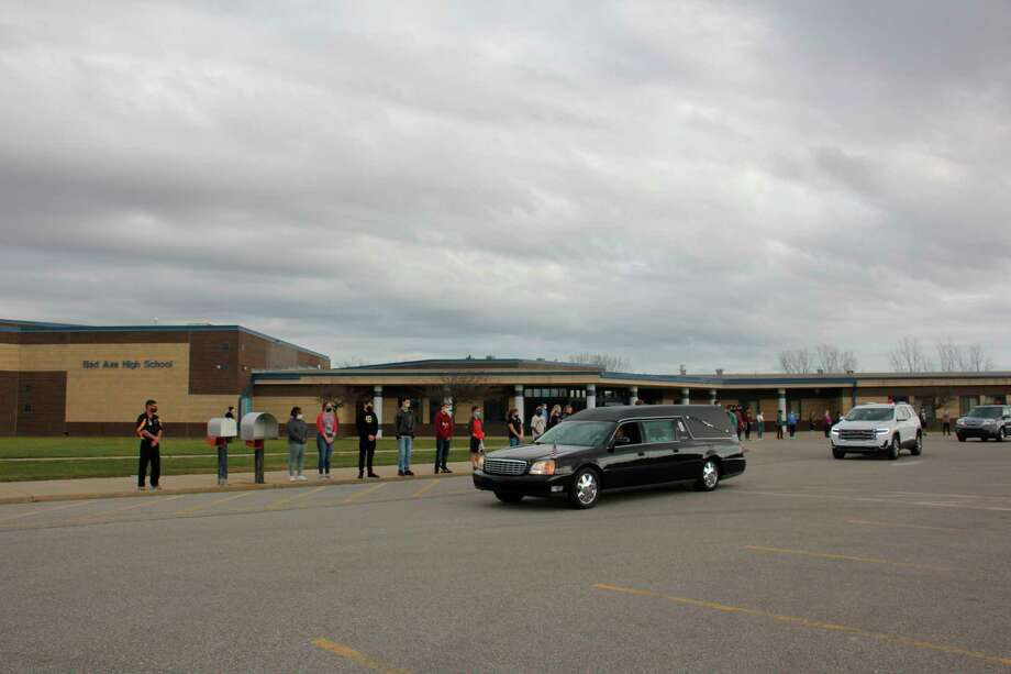 The Bad Axe student body lined the sidewalks of the elementary, junior high, and high school Tuesday November 11 to say a final goodbye to John Rowland, who is remembered as a Hatchet icon. (Paige Withey/Huron Daily Tribune)