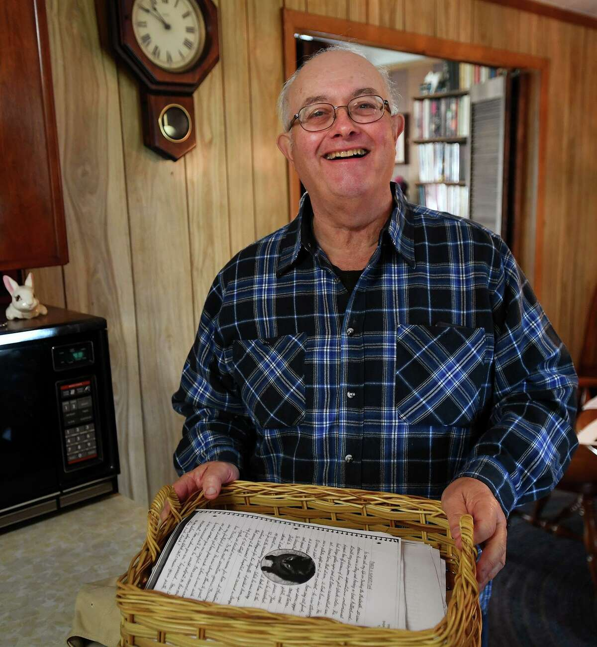 """Albert Ruggiero, of Milford, took a basket full of his late wife's writings to publish """"Pearls from Carole"""", a collection of whimsical, autobiographical short stories, in Milford, Conn. on Wednesday, Nov. 5. Carol Ruggiero passed away in March of this year."""