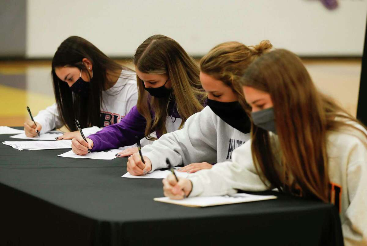 Eryn Garza, left, Remington Isaac, Riana McWhirter and Abbey Wilson signed national letters of intent during a national signing day ceremony at Montgomery High School, Wednesday, Nov. 11, 2020, in Montgomery.