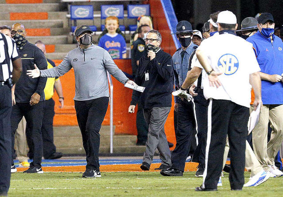 Missouri coach Eliah Drinkwitz gestures toward Florida coach Dan Mullen, obscured at right, after a fight broke out at the end of the first half Oct. 31 Gainesville, Fla. Saturday's SEC between Mizzou and Georgia has been postponed because of COVID-19 concerns. Photo: AP Photo