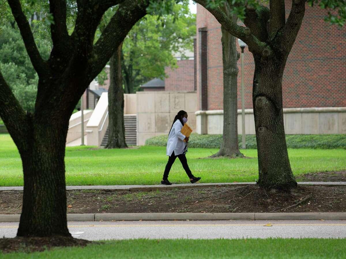 A person walks on Prairie View A&M University's campus Thursday, June 25, 2020, in Prairie View.