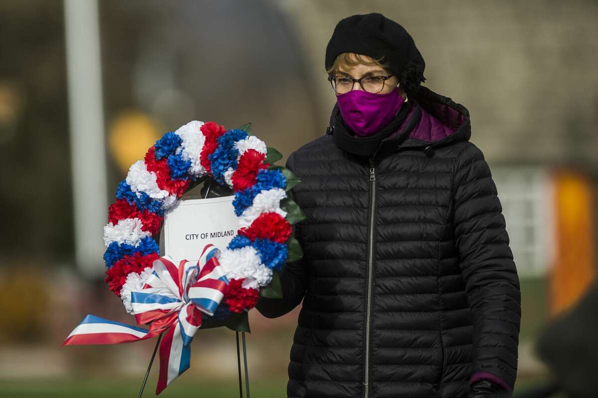 Mayor Maureen Donker places a wreath during a Veteran's Day ceremony Wednesday, Nov. 11, 2020 at the Veteran's Memorial in downtown Midland. (Katy Kildee/kkildee@mdn.net)