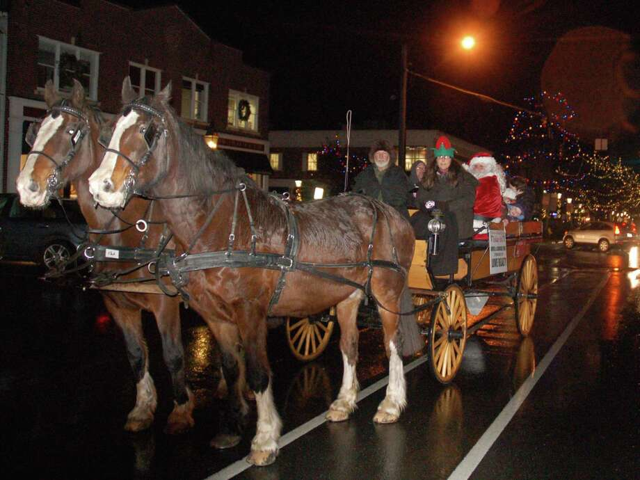 Carriage rides are a traditional part of the Holiday Stroll which organizers say may return as part of this year's Ridgefield Holiday Village. Photo: Macklin Reid / Hearst Connecticut Media