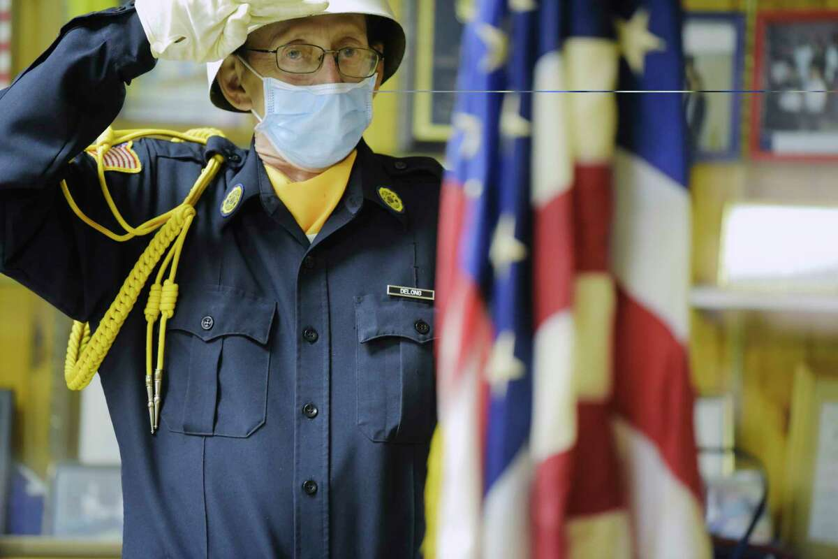 George DeLong, a member of the Son's of the American Legion Post 927, salutes during the playing of the National Anthem during a ceremony at the Green Island American Legion on Wednesday, Nov. 11, 2020, in Green Island, N.Y. (Paul Buckowski/Times Union)