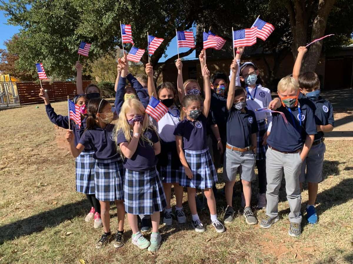 Trinity School third-grade students placed flags along Wadley Ave. Wednesday, Nov. 11, 2020, for Veteran's Day.