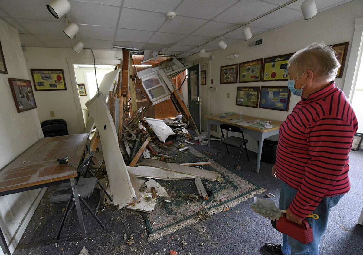 Lynne Cole looks over the devastation inside of the Kate Mullany National Historic Site house which was badly damaged Tuesday afternoon when an SUV crashed through the rear of the building and rolled into the structure on Wednesday, Nov. 11, 2020 in Troy, N.Y. (Lori Van Buren/Times Union)