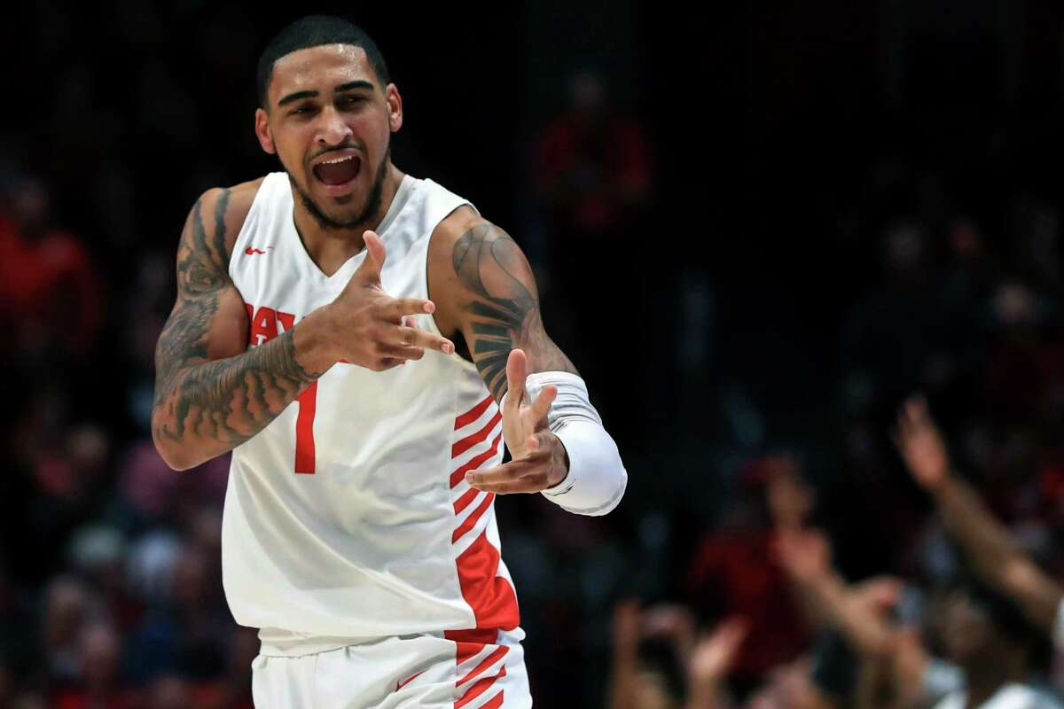 In this Feb. 11, 2020, file photo, Dayton's Obi Toppin (1) reacts in the first half in an NCAA college basketball game against Rhode Island in Dayton, Ohio. Toppin was selected to the Associated Press All-America first team.