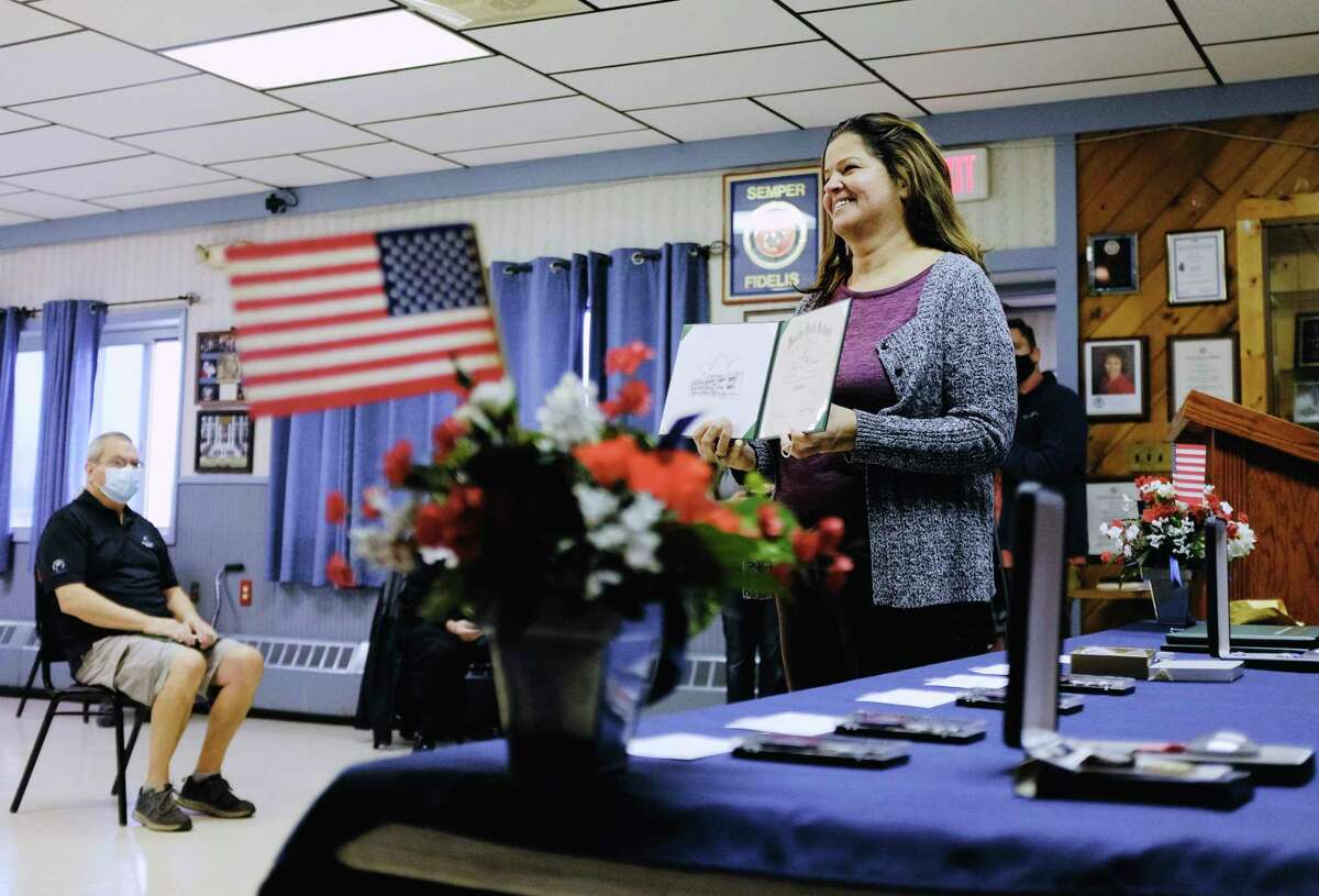 Pam Springer shows off the Green Island Union Free School District high school diploma awarded to her late father, U.S. Air Force veteran Paul McClure, during a ceremony at the Green Island American Legion on Wednesday, Nov. 11, 2020, in Green Island, N.Y. Eleven veterans were awarded their high school diplomas through the program Operation Recognition. The program allows school districts to award diplomas to students who left school prematurely to serve in the military. Paul McClure passed away in 2011. (Paul Buckowski/Times Union)