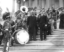 "FILE -- Vice President Charles Curtis, center, attends a performance by the United States Indian Band on the steps of the Capitol in Washington on May 11, 1929. Historians and Native Americans are revisiting the legacy of Curtis, whose Kaw Nation ancestry gives him a claim as the first ""person of color"" to serve as vice president, though the term's current usage emerged decades later. (The New York Times)"