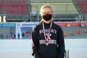 Alexis Tracy proudly wears her latest all-state medal after a strong finish to her senior year at cross country state finals on Nov. 7. (Photo/Robert Myers)