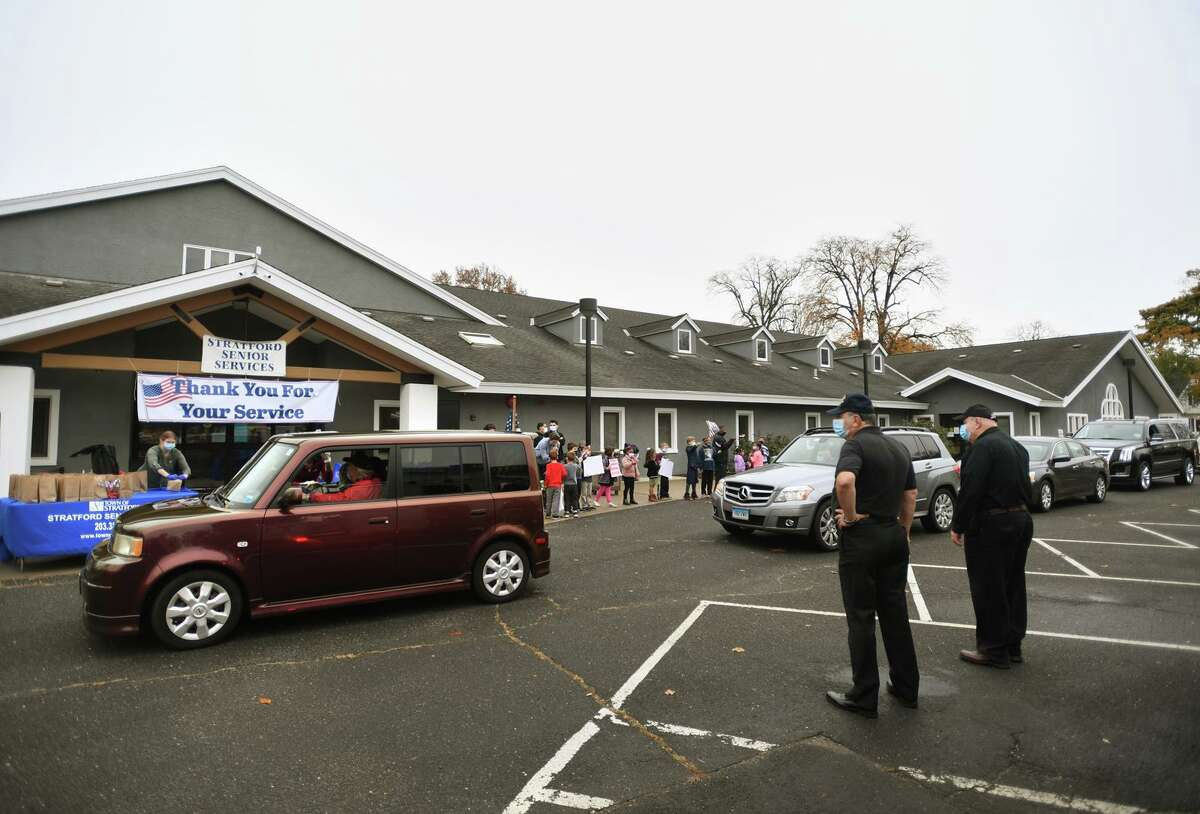 Veterans are welcomed in their cars to receive a Veterans Day takeaway breakfast outside the Balwin Community Center Stratford, Conn. on Wednesday, November 11, 2020.