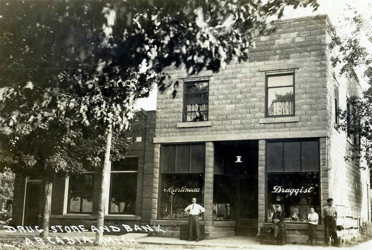 This photo shows an exterior view of the bank and drug store located in Arcadia circa 1915. (Manistee County Historical Museum photo)