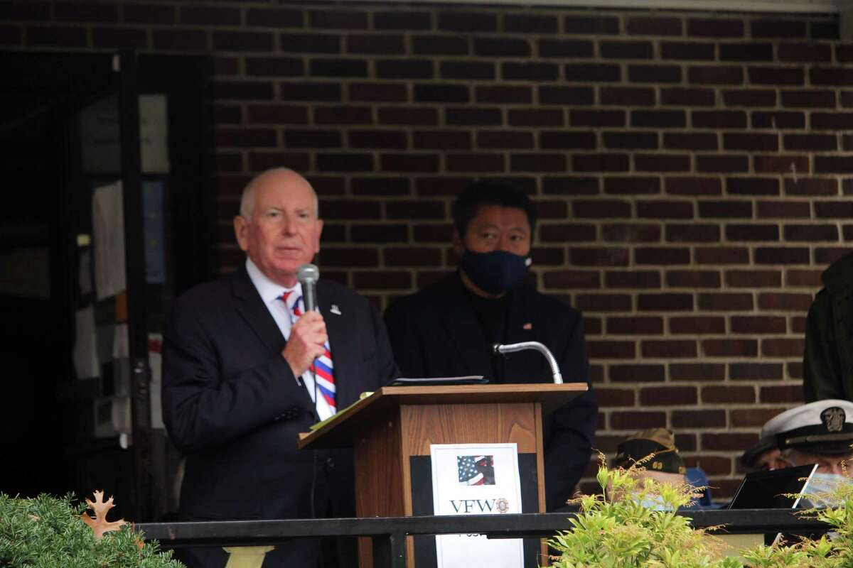 First Selectman Jim Marpe speaks before a small gathered crowd at VFW Post 399 in Westport to honor Veterans Day. Taken Nov.11, 2020 in Westport, Conn. First Selectman Jim Marpe gave a brief speech to honor veterans, highlighting how the country faced the Spanish Flu pandemic at the end of World War I, a little over 100 years ago. Now, years later new soldiers have been called upon amid a new pandemic - COVID-19.