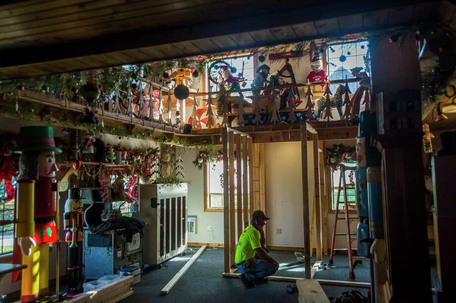 Jeff Grunder works on constructing a small room within the Santa House, where Santa will be able to be viewed by guests through a see-through barrier, Wednesday, Nov. 4. (Katy Kildee/kkildee@mdn.net)