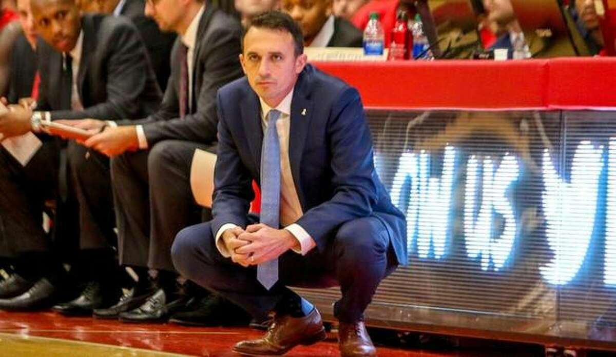 SIUE men's basketball coach Brian Barone watches intently from the sideline in front of the scorer's table during a game last season.