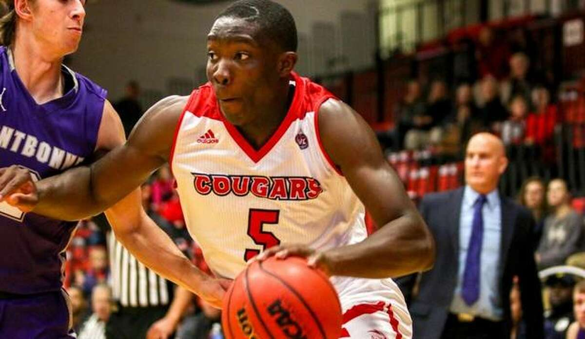 SIUE guard Mike Adewunmi dribbles hard to the basket during a game last season.