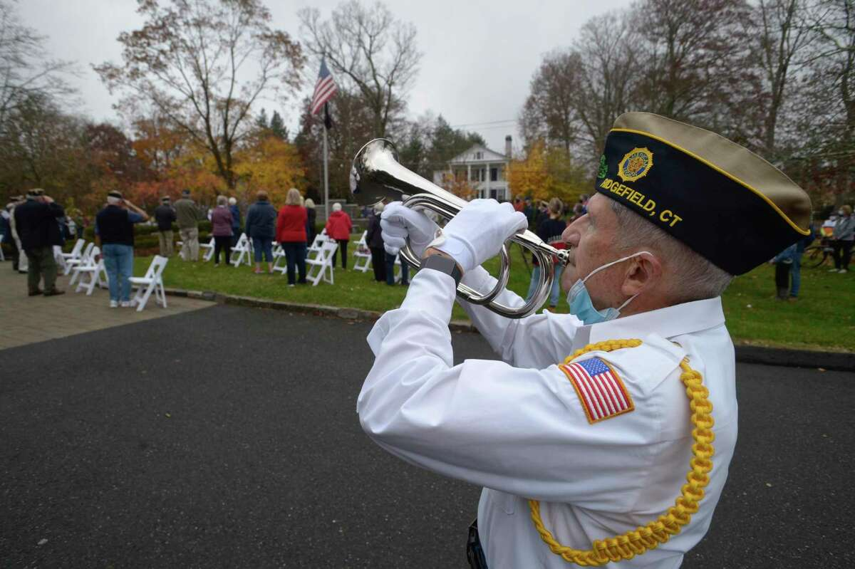 """George Schuster presented """"Taps"""" at the American Legion Post 78 Veterans Day Ceremony at Lounsbury House in Ridgefield on Wednesday."""