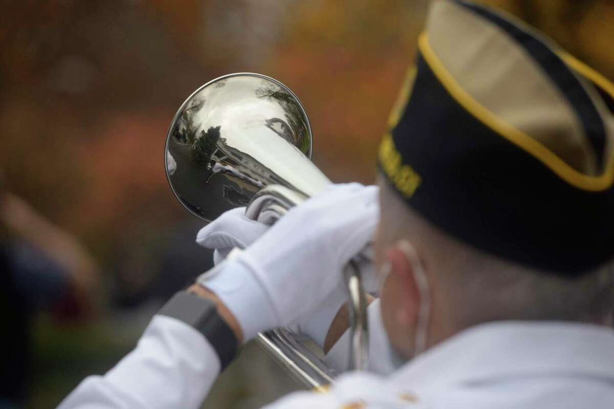 George Schuster presented taps at the American Legion Post 78 Veterans Day Ceremony at Lounsbury House, Ridgefield, Conn. Wednesday, November 11, 2020.