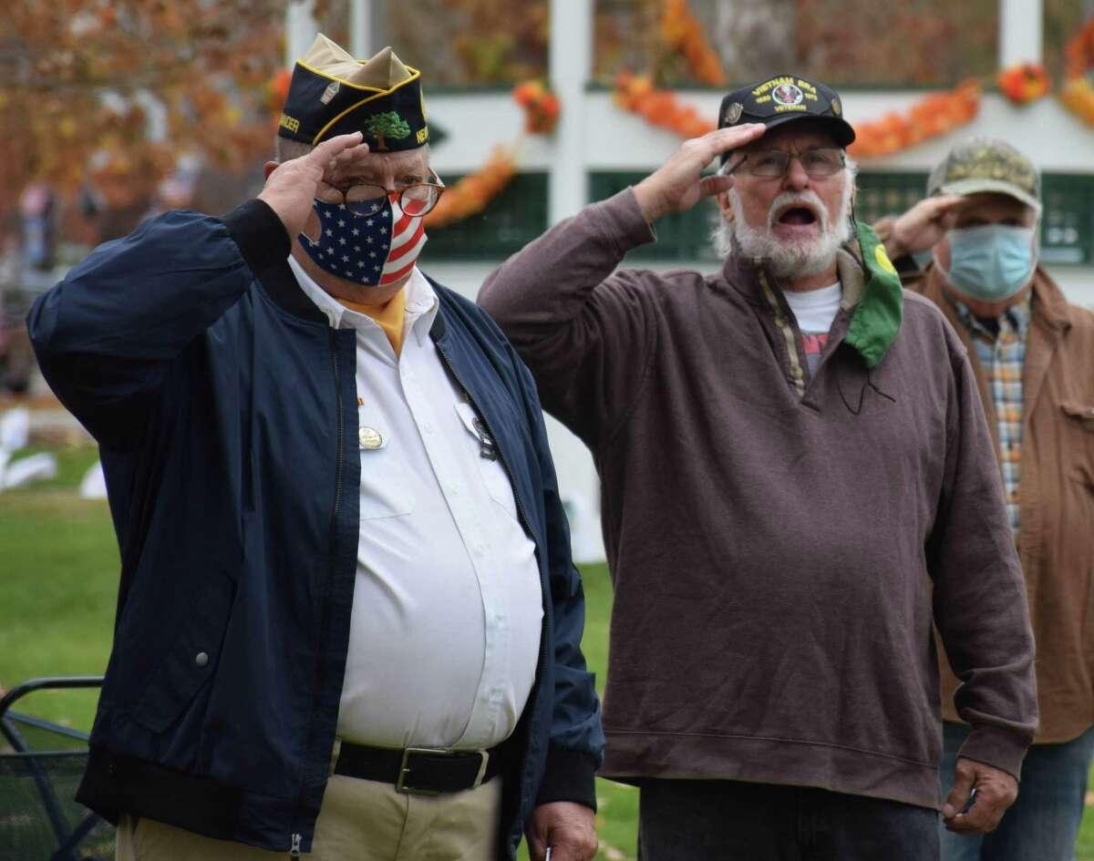 American Legion Commander Jeff McBreairty, left, and Buck Oviatt of Buck and the Buckshots offer a salute as Oviatt sings the National Anthem.