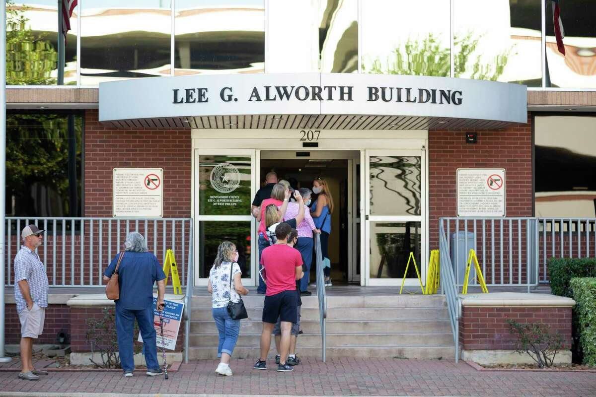 Residents wait in line outside the Lee G. Alworth Building on the first day of Early Voting, Tuesday, Oct. 13, 2020.