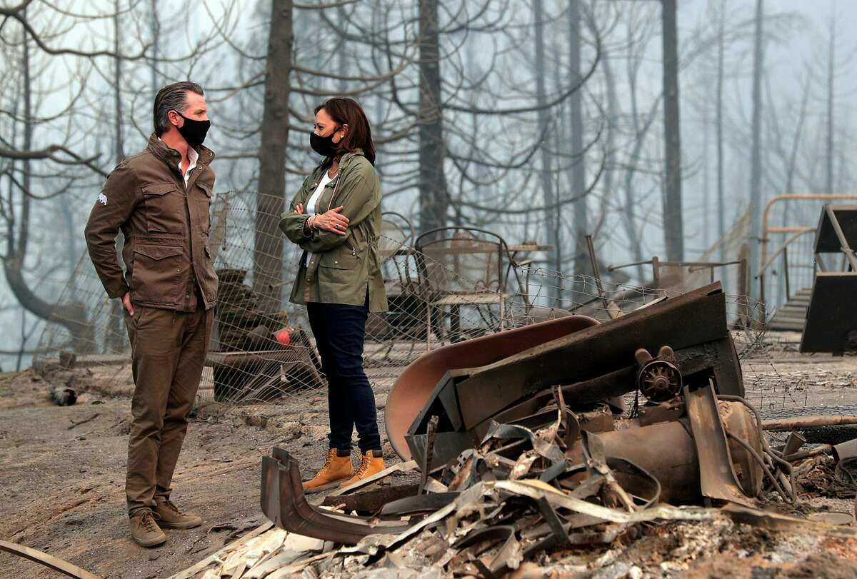 Gov. Gavin Newsom and Sen. Kamala Harris review the devastation of the Creek Fire in Pineridge in September. Newsom's new budget proposal includes about $1 billion in funds for fire prevention efforts.
