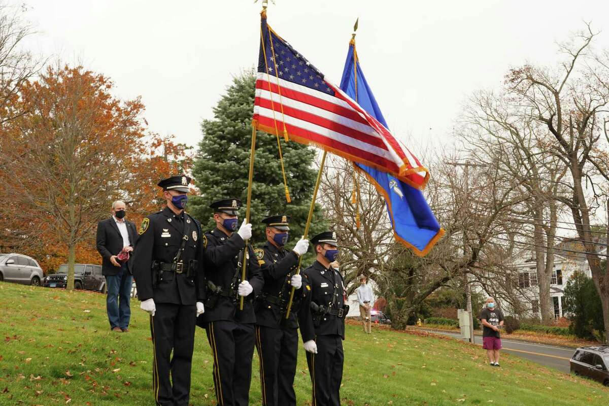 """The New Canaan Police Department served as color guard for the Veterans Day ceremony in God's Acre in New Canaan on Nov. 11, 2020. Nash thanked VFW Post 653, which """"offered nothing but support and a helping hand during my own transition to civilian life."""" """"Aside from my own wife and son, I have never learned more about family than from my men in Alpha Company 214 infantry of the 10th Mountain Division, from the community surrounding the 1st Armored Division, first Striker Brigade, and from my brothers in the 75th Ranger Regiment. """"While today we proudly salute the service of all of our veterans, we must remember those who gave all, those who haven't been found and those who are currently in harm's way,"""" he said. """"We must remember those on the streets and those who struggle to see the light of each new day,"""" he said. """"Service and sacrifice do not span the course of a single holiday each November. Our armed forces stand ready to defend this county at all hours and on every day of the year. Let Veteran's Day be a day that refreshes those thoughts for next 365 days,"""" Nash said\ """"Ask a veteran about their service and ask why it mattered to them,"""" he said. In civilian life, Nash is an associate director at UBS Investment Bank within their Equity Capital Markets team in Darien."""
