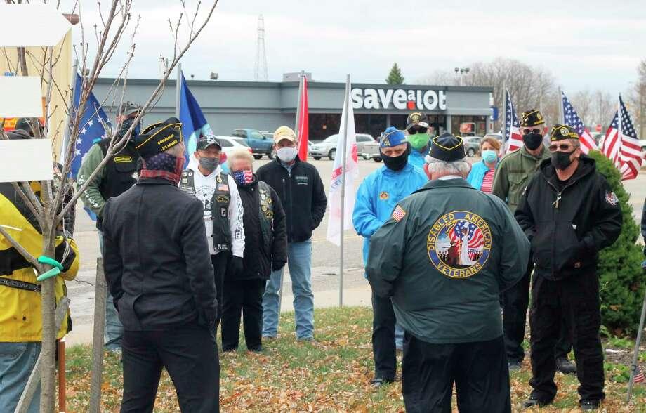 DAV Salt City Chapter No. 43 treasurer Birney Summers addresses those in attendance at the Veterans Day ceremony at Manistee Veterans Memorial Park on Wednesday. (Kyle Kotecki/News Advocate)
