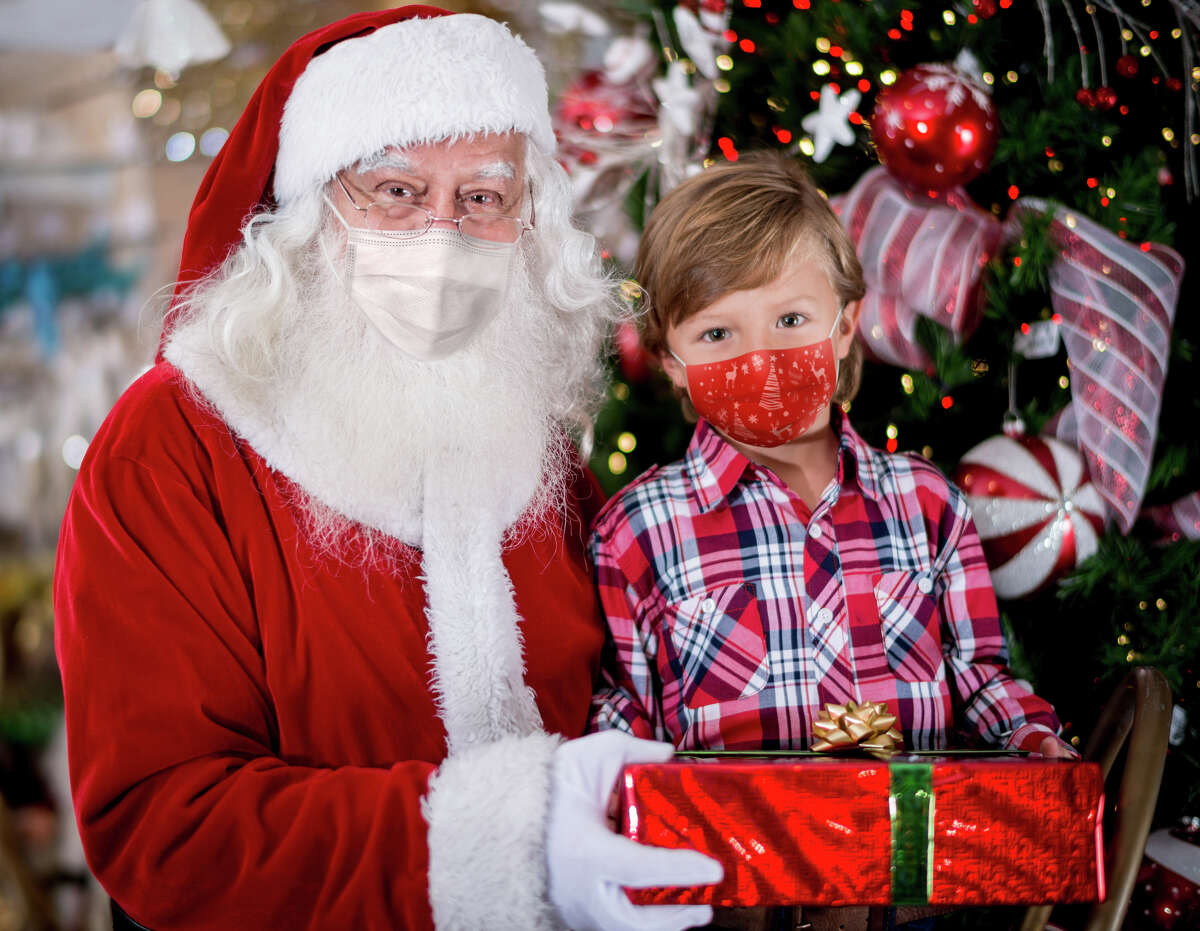 Masked Santa? Holiday photos look different this year amid virus