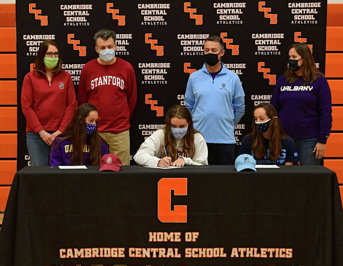 Cambridge athletes (sitting from left) Lilly Phillips (UAlbany basketball), Fiona Mooney (Stanford rowing), and Sophie Phillips (Rhode Island basketball), sign letters of intent at Cambridge High School on Wednesday, Nov. 11, 2020 in Cambridge, N.Y. (Lori Van Buren/Times Union)