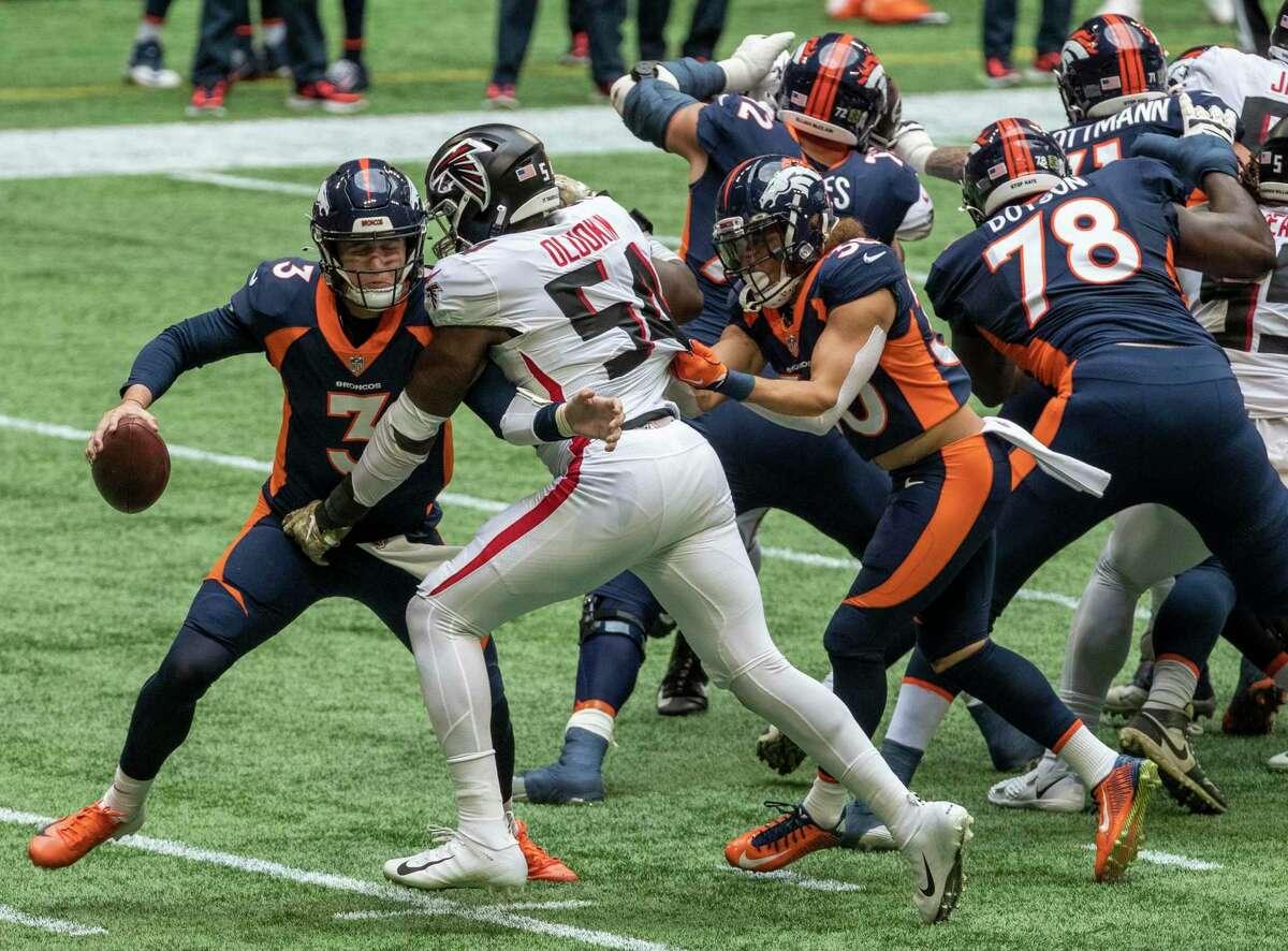 Atlanta Falcons linebacker Foye Oluokun (54) sacks Denver Broncos quarterback Drew Lock during the second quarter of Sunday's name. Oluokun, a former Yale star, was named the NFC Defensive Player of the Week.
