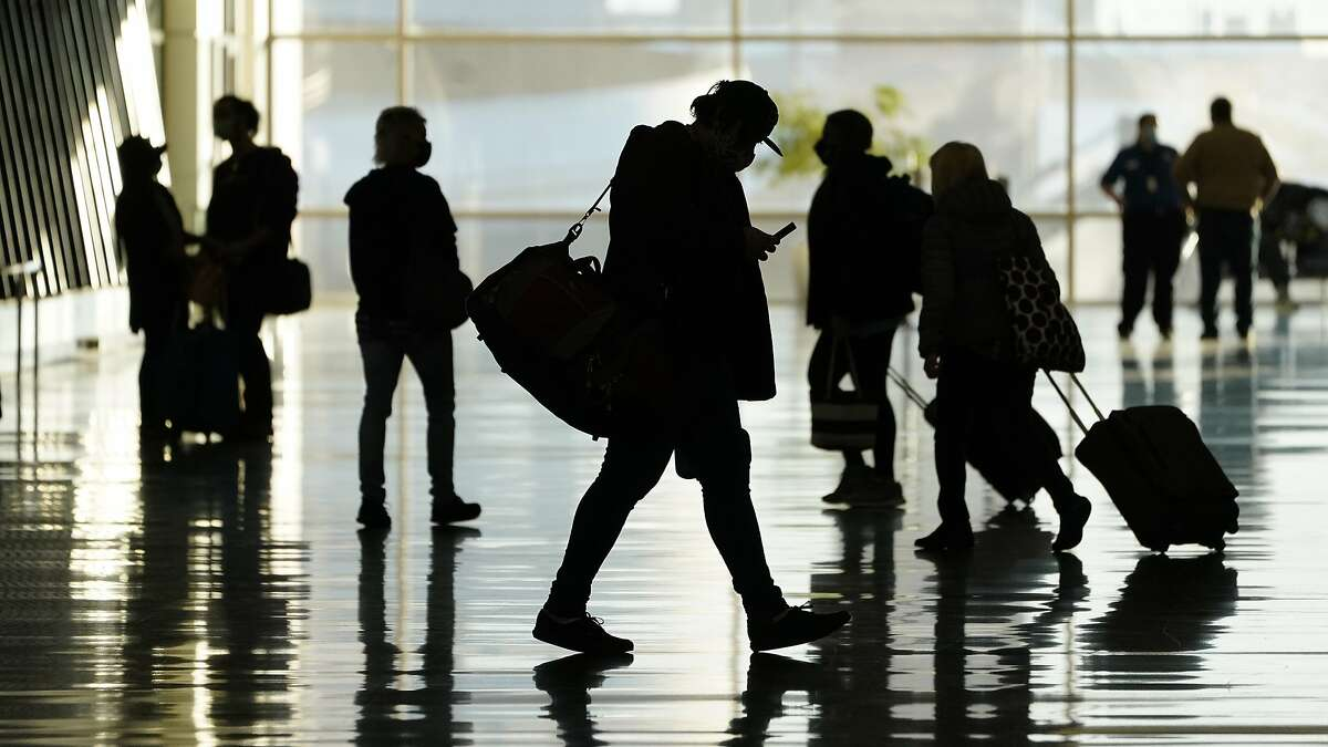 Passengers walk through Salt Lake City International Airport, in Salt Lake City on Oct. 27, 2020.