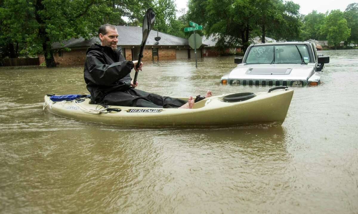 Kyle Lester paddled past a submerged SUV in the Timber Lakes-Timber Ridge subdivision, south of The Woodlands on April 18, 2016. The Woodlands Township Storm Drainage Task Force has a new name - the One Water Task Force - and a newly expanded mission that includes a new focus on ground water, surface water and subsidence. The task force first focused on flooding and drainage issues that arose in the township and south Montgomery County after the April 2016 Tax Day Floods and the May 2016 Memorial Day Floods.