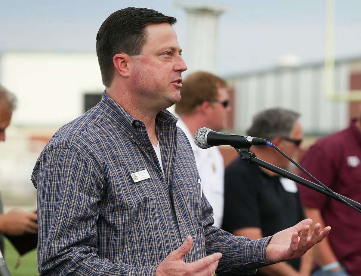 Magnolia Mayor Todd Kana provides some opening remarks before reading The Prayer for the Nation during the National Day of Prayer ceremony on Thursday, May 1, 2014, at Magnolia High School Stadium.