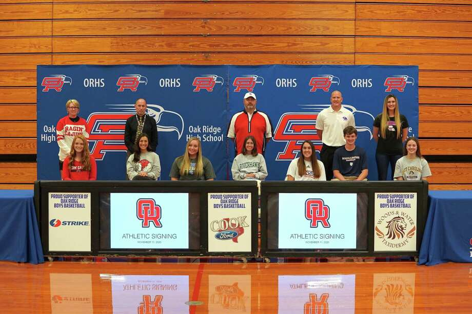 From left: Samantha Graeter, Lily Revelas, Morgan Dutton, Nicole Anderson, Piper Boydstun, Ryan Przespolewski and Alex Singleton celebrated their college signings on Wednesday. Photo: Ted Bell