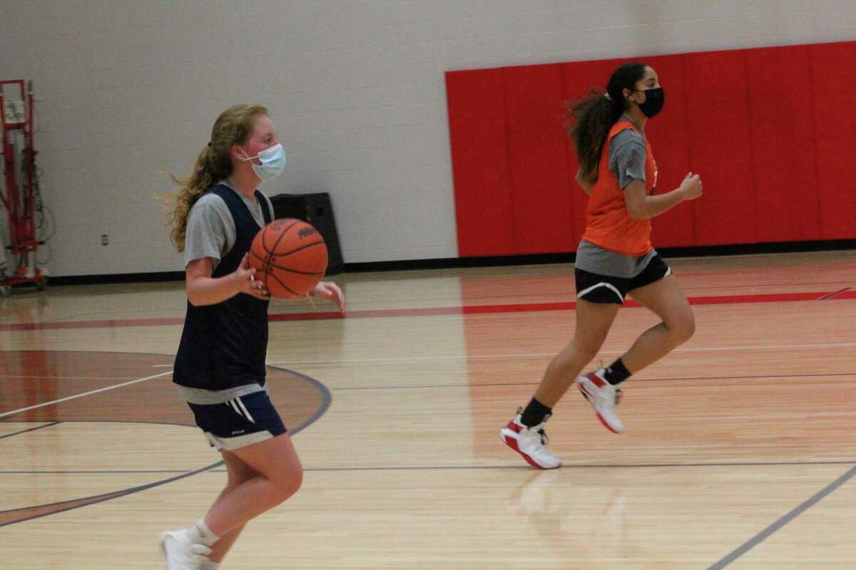 Big Rapids' Ariana Costie (left) brings the ball down the court on Tuesday during a practice in a new auxiliary gymnasium. (Pioneer photo/John Raffel)