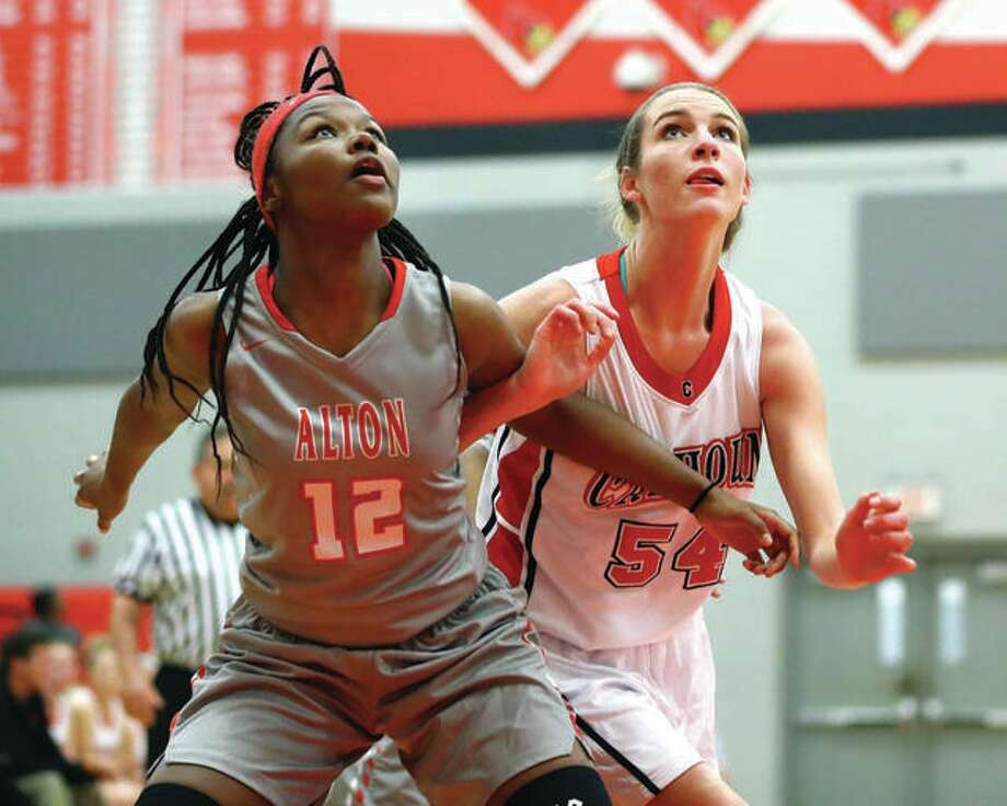 Calhoun's Grace Baalman (right) works for position against Alton's Leilani Hill for a rebound during a 2016 game. The IHSA is inviting representatives from all groups involved to take part in a meeting next week to attempt to work out plans for girls ad boys basketball during the COVID-19 pandemic. Photo: Telegraph File Photo
