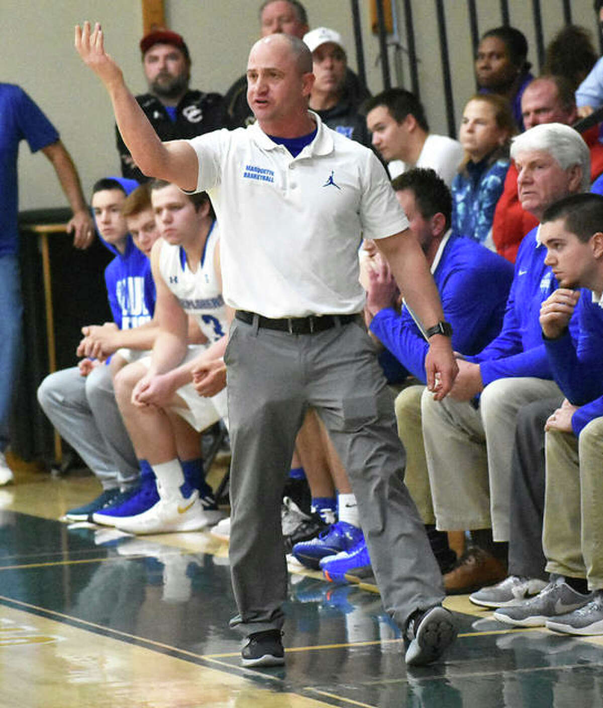 Marquette Catholic coach Steve Medford directs his team. Marquette is one of many schools waiting to see if the IHSA can work out its coronavirus dilemma so that boys and girls basketball can be played this school year.