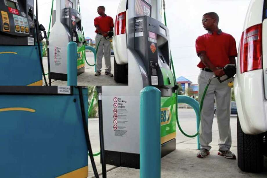"""Dwight """"Barron"""" Jones fills up his taxi with E85 fuel at the Valero Corner Store at 4801 Walzem Road on Wednesday."""
