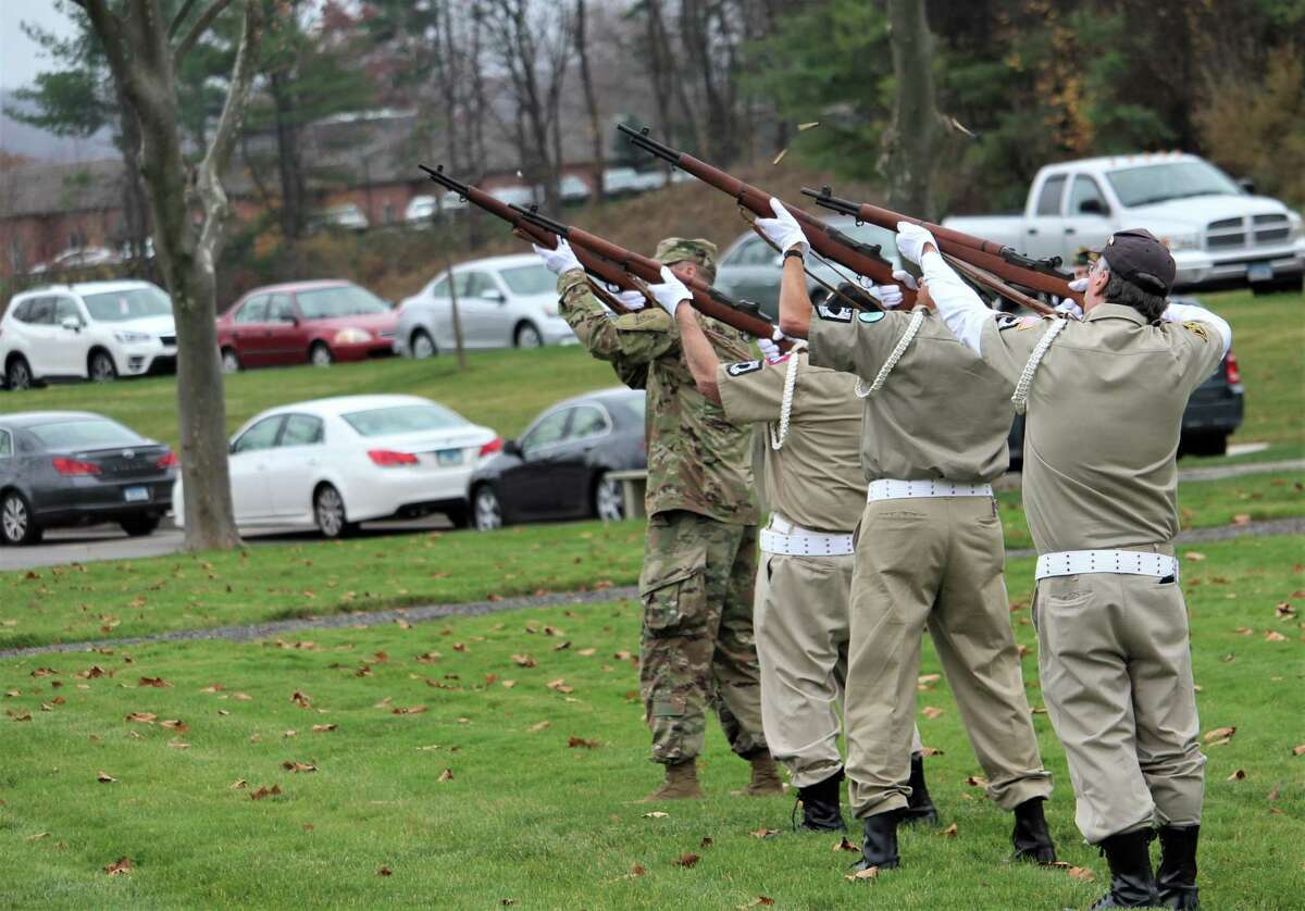 About four dozen people, including many veterans, gathered Wednesday afternoon at the State Veterans Cemetery on Bow Lane in Middletown to mark Veterans Day.
