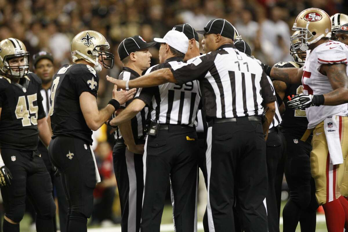 Drew Brees of the New Orleans Saints states his case to the officials after a high hit during the game against the San Francisco 49ers at the Superdome on November 17, 2013, in New Orleans. The Saints defeated the 49ers 23-30.