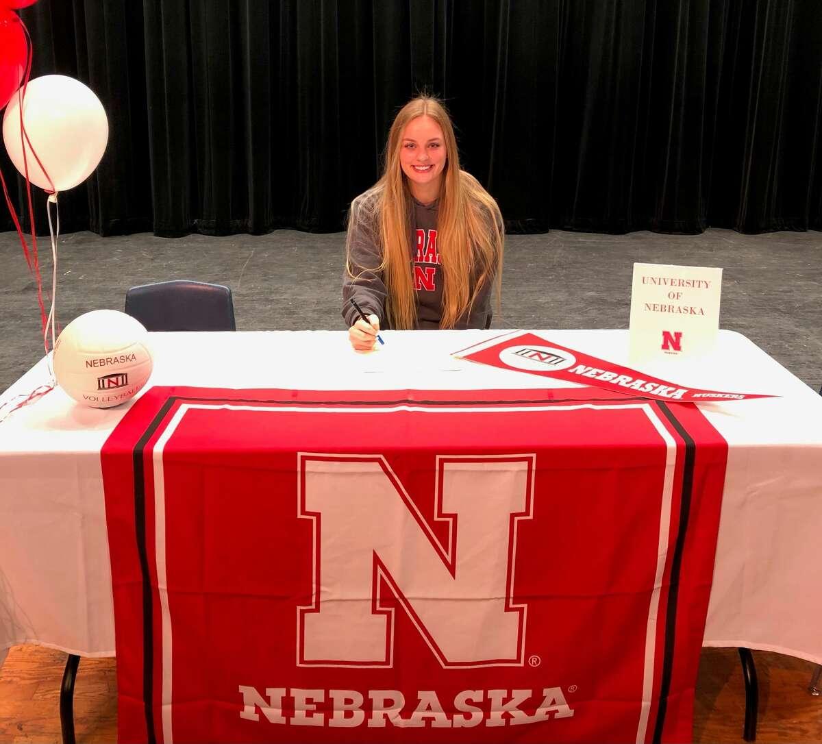 Seven Lakes' Ally Batenhorst signed a volleyball scholarship with Nebraska.